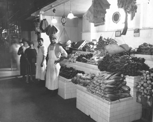A photo of a fruit and vegetable stand.